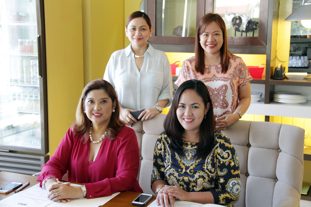 Seated from left: Anne Certeza-Palmares, former CCA, Manila Senior Corporate PR Manager; Marjorie Cleofas, Sysu Trade Marketing Manager. Standing, from left: Marie Dizon, CCA, Manila Corporate Public Relations Manager and Angelica Villanueva, Sysu Trade Marketing Officer. Photo courtesy of Cravings Group
